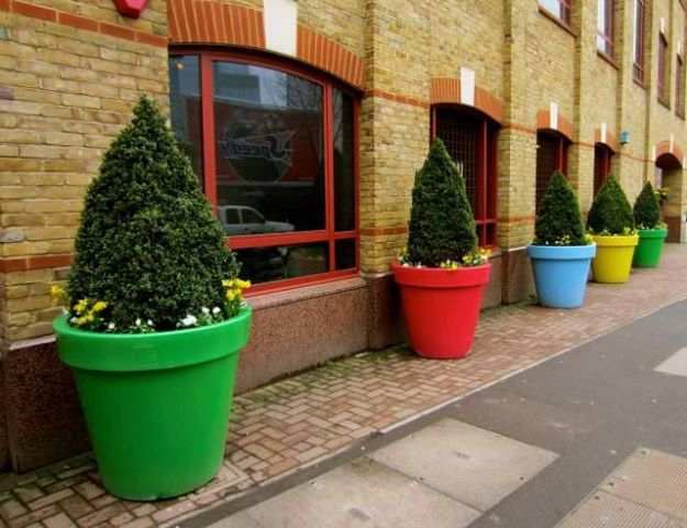 colorful big flower pots Urban space and Architecture