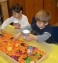 sensory bin containing halloween candy corn was added to our preschool