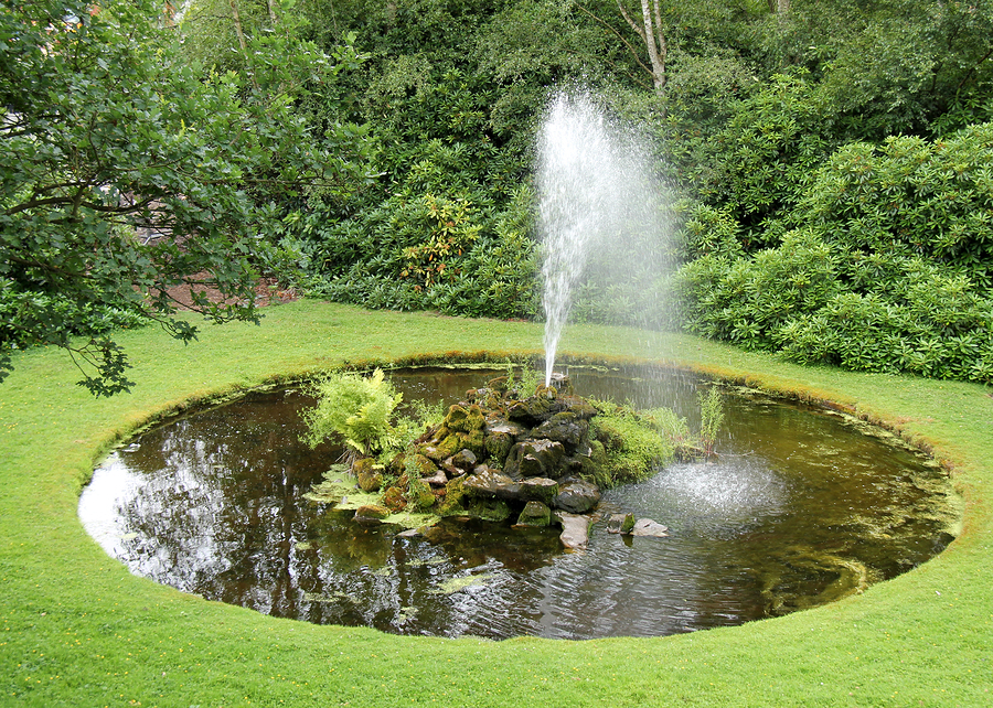 pond water fountains Prestige One Landscaping Backyard Fountains